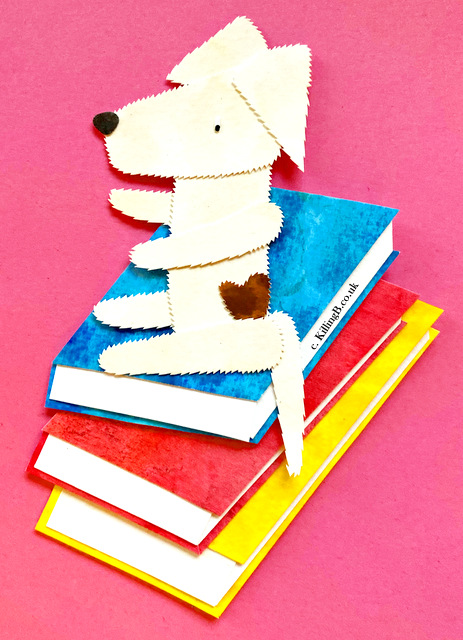 Dog on Book Pile